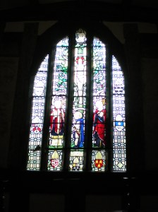 Chapel at Little Moreton Hall, Congleton, Cheshire, showing Jesus and some of the Saints